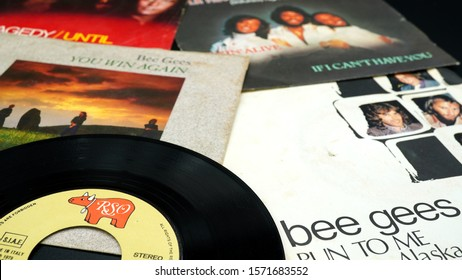 Rome, Italy - November 18, 2019: 45 rpm covers of the BEE GEES group. composed of the brothers Barry, Robin and Maurice Gibb, the most successful artists in the history of music with over 230 million