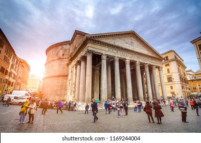 Rome, Italy - November 2, 2018: Tourists visit the Pantheon in winter. Roman Pantheon is one of the best-known sights of Rome. Pantheon square with the ancient Egyptian obelisk in morning.