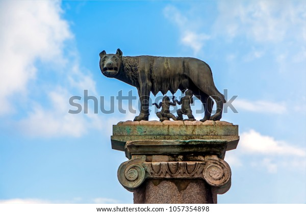 Rome, Italy - November 20, 2016: The Capitoline Wolf: Statue of the she-wolf suckling Romulus (founder of Rome) and Remus on blue sky background: the icon of the founding of the city of Rome
