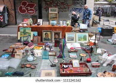 Rome, Italy - November 2017: Two sellers and their vintage treasures at Porta Portese flea market