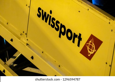 Rome, Italy - November 3, 2018: Swissport movable stairs on the runway. Swissport International Ltd. is a Swiss aviation services company providing airport ground and cargo handling services