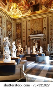 ROME, ITALY - NOVEMBER 4, 2017:  Entrance hall of the Borghese Gallery in Rome, Italy with marble sculptures, paintings, murals, antiquities and painted ceilings on display.