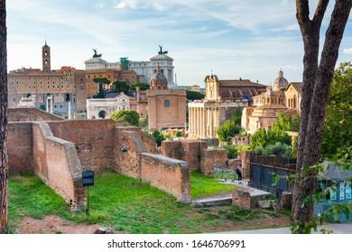 Rome, Italy - Oct 02, 2018: View of the park Orti Farnesiani sul Palatino in Rome, Altare della Patria and Basilica dei Santi Cosma e Damiano visible in the distance