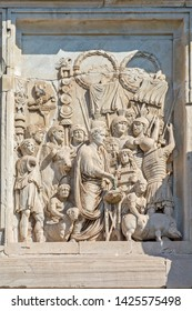 """Rome, Italy - Oct 03, 2018: Detail of the triumphal arch of Constantine. Lustratio , The bas-relief on the south side  """"Purification by Sacrifice."""""""