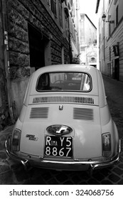 ROME, ITALY - OCTOBER 03 2015: A Fiat 500 parked in Rome, Italy. It soon become an Italian symbol.