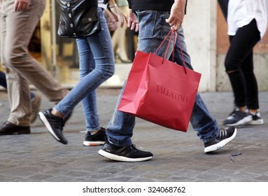 ROME, ITALY - OCTOBER 03 2015: People walk with their Valentino shopping bag on Via Ripetta, main shopping street in the center of Rome, Italy