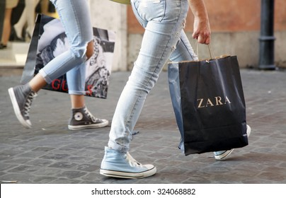 ROME, ITALY - OCTOBER 03 2015: People walk with their Zara shopping bag on Via Ripetta, main shopping street in the center of Rome, Italy