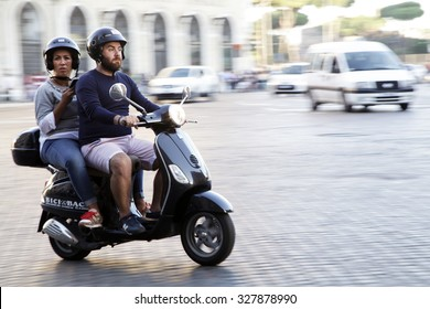 ROME, ITALY - OCTOBER 03 2015: A couple ride a Vespa on the street in Rome; Italy. Vespa scooter is an italian symbol.