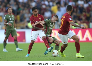 Rome, Italy - October 06,2019:Justin Kluivert (AS ROMA), Marko Rog (Cagliari)  in action during the Italian Serie A soccer match  between AS ROMA and CAGLIARI, at Olympic Stadium in Rome.