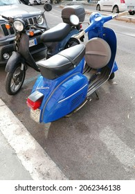 Rome, Italy - October 09, 2021, Vespa Piaggio Turismo. The Vespa is a scooter model from Piaggio, patented on 23 April 1946, based on a design by the aeronautical engineer Corradino D'Ascanio.
