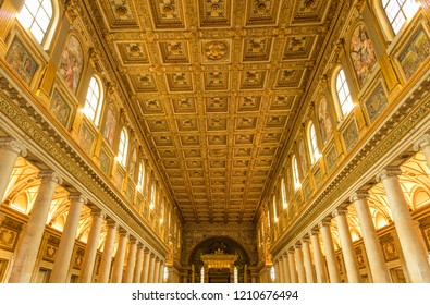 Rome, Italy - October 1, 2018:  A wide-angle view of the 16th-century coffered golden ceiling of the nave in The Basilica of Santa Maria Maggior.