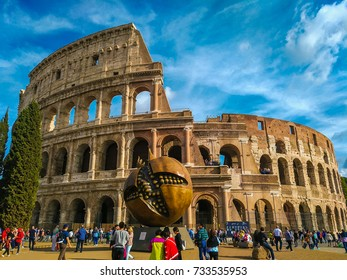 ROME, ITALY - OCTOBER 10, 2017: Full view of the colosseum with the pomegranade sculpture in Rome, Lazio, Italy