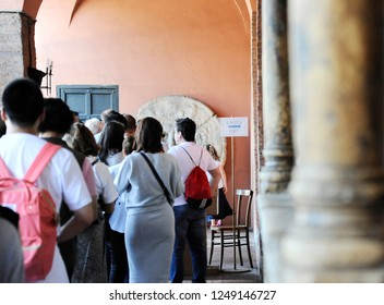 Rome, Italy – October 10, 2018: Visitors waiting to see the mouth of truth (Bocca della Verità). It attracts visitors who audaciously stick their hand in the mouth. Santa Maria in Cosmedin in Rome