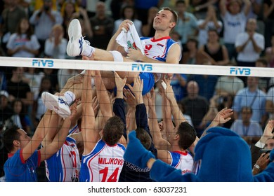 ROME, ITALY - OCTOBER 10: Serbia team celebrates victory at Volleyball World Championships bronze medal match Italy vs Serbia at Palalottomatica in Rome on October 10, 2010