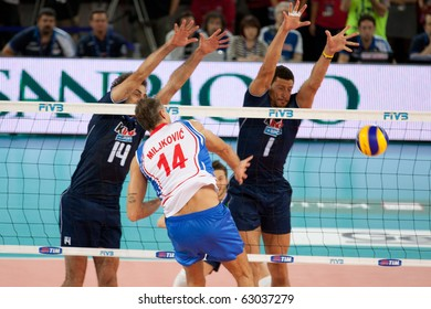ROME, ITALY - OCTOBER 10: Serbia Ivan Miljkovic spikes ball at Volleyball World Championships bronze medal match Italy vs Serbia at Palalottomatica in Rome on October 10, 2010