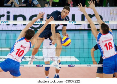 ROME, ITALY - OCTOBER 10: Italy Simone Parodi spikes ball at Volleyball World Championships bronze medal match Italy vs Serbia at Palalottomatica in Rome on October 10, 2010