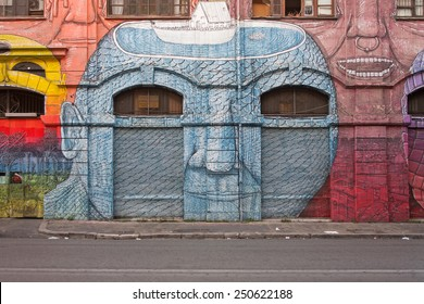 ROME, ITALY - OCTOBER 13, 2014 - Graffiti by street artist Blue on a building facade in Ostiense district.