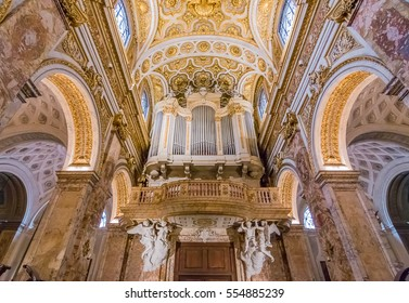 Rome, Italy - October 13, 2016: Ornate interior and organ of baroque church of St. Louis of the French, San Luigi dei Francesi in Rome, Italy by Piazza Navona, known for itâ??s Caravaggio paintings