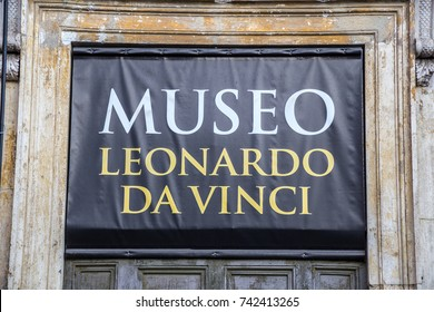 ROME, ITALY - OCTOBER 20, 2017: Sign for Leonardo da Vinci museum at the famous Basilica Santa Maria in Piazza del Popolo.