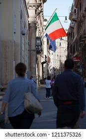 Rome, Italy - October 20 2018: The Italian national flag flies near Venezia Square in Rome, Italy,