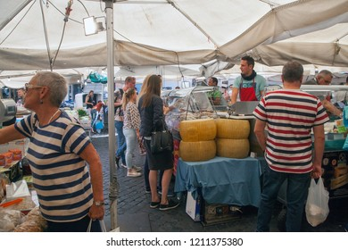 Rome, Italy - October 20 2018: Variety of traditional Italian products for sale in Campo de Fiori, famous outdoor market in central Rome, Italy.
