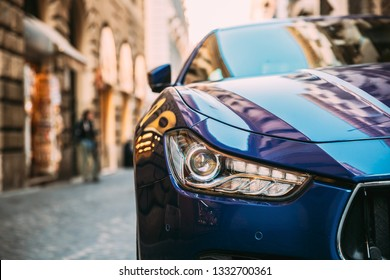 Rome, Italy - October 20, 2018: Close Up Headlight Of Blue Color Maserati Ghibli M157 Car Parked At Street