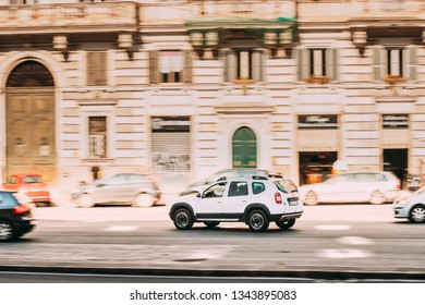 Rome, Italy - October 20, 2018: Car Dacia Duster SUV Fast Moving At City Street. Duster produced jointly by the French manufacturer Renault and its Romanian subsidiary Dacia since 2010