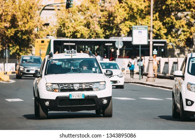 Rome, Italy - October 20, 2018: Taxi Car Dacia Duster SUV In Summer City Street. Duster produced jointly by the French manufacturer Renault and its Romanian subsidiary Dacia since 2010