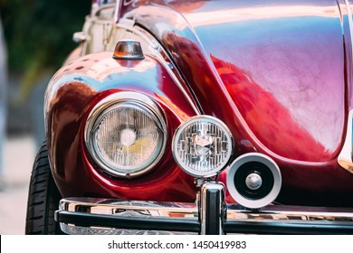 Rome, Italy - October 20, 2018: Close Up Headlight Of Old Retro Vintage Red Color Volkswagen Beetle Car Parked At Street