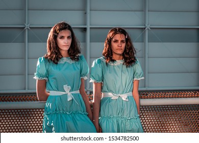 """Rome, Italy, October 2019. Scenes from comicon. The iconic twin sisters from """"The Shining"""". Halloween period, costume design, holidays and party concept."""
