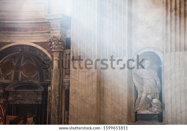Rome, Italy - October 27 2008: Rays of lights in Saint Peters Cathedral in Vatican
