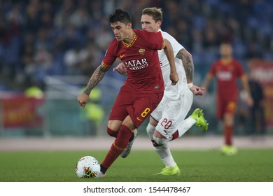 Rome, Italy - October 27, 2019: Diego Perotti (AS ROMA), Biglia (milan) in action during the Italian Serie A soccer match  between AS ROMA and AC MILAN, at Olympic Stadium in Rome.