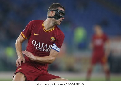 Rome, Italy - October 27, 2019: Edin Dzeko (AS ROMA) in action during the Italian Serie A soccer match  between AS ROMA and AC MILAN, at Olympic Stadium in Rome.