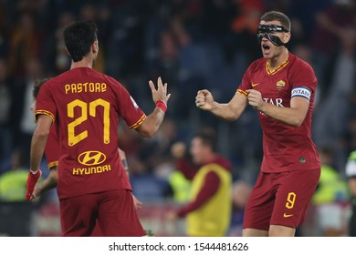 Rome, Italy - October 27, 2019:Mirko Antonucci (AS ROMA), Edin Dzeko (AS ROMA) celebrates Zaniolo goal during the Italian Serie A soccer match  between AS ROMA and AC MILAN, at Olympic Stadium in Rome