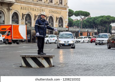 Rome, Italy - October 29, 2014: policeman in Rome, directs traffic in Piazza Venezia, in Rome