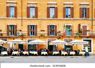 ROME, ITALY - OCTOBER 29: Guests sit on the beautifull restaurant terrace in Piazza Navona in Rome, Italy on October 29, 2014