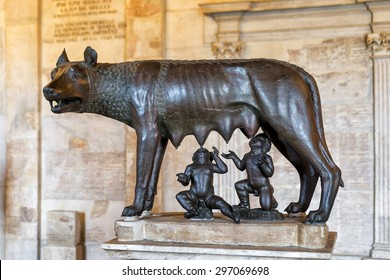 ROME, ITALY - OCTOBER 3, 2012: The bronze statue of the Capitoline Wolf (Lupa Capitolina) in the Capitoline Museum. She-wolf feeds little Romulus and Remus. Etruscan art.