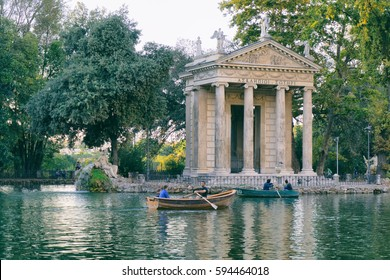 ROME, ITALY - OCTOBER 3, 2016: Temple of Asclepius in a pond in Villa Borghese, Rome Italy. People are renting boats for romantic moment.