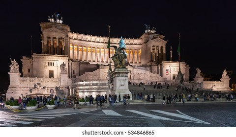 ROME, ITALY - OCTOBER 31, 2016: tourists near Altare della Patria (Altar of Fatherland, Monument to Victor Emmanuel II) in Rome city in night. Construction the palace continued from 1885 to 1935.