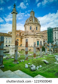 ROME, ITALY. October 31, 2018: The Church of the Most Holy Name of Mary at the Trajan Forum and the Trajan's Column. Roman triumphal column in Rome, Italy, that commemorates Roman emperor Trajan.