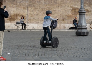 Rome, Italy - October 31, 2018: Child riding a Segway. The Segway PT is a two-wheeled, self-balancing scooter
