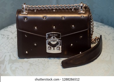 Rome, Italy - October 31, 2018: Miu Miu leather handbag. Miu Miu is an Italian high fashion women's clothing and accessory brand and a fully owned subsidiary of Prada