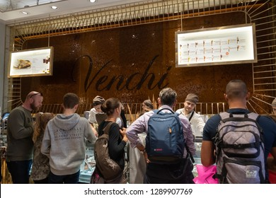 Rome, Italy - October 31, 2018: Venchi chocolate store interior full of people. Venchi is an Italian gourmet chocolate manufacturer