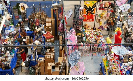 Rome, Italy - October 5, 2019: Busy shops at ROMICS Festival (Rome Comics), twice a year the iconic gathering and market of comics/cartoons/manga/video games/cosplay lovers. Colorful items on sale