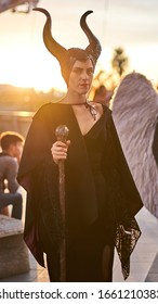Rome, Italy - October 5, 2019: Maleficent cosplayer at ROMICS Festival (Rome Comics), twice a year the iconic gathering of films/cartoons/cosplay lovers. Beautiful curved horns. Outdoors, Sunset