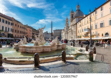 ROME, ITALY - OCTOBER 8: Tourists at Piazza Navona on October 8, 2018 in Rome, Italy. Piazza Navona is a popular destination in Rome, the most visited city in Europe.