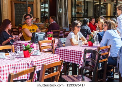 ROME, ITALY, on March 11, 2017. People eat and have a rest in cafe on the city street in the downtown