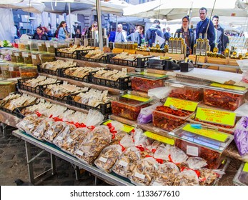 ROME, ITALY, on March 11, 2017. Various authentic Italian farmer bio products are laid out on market counters at Campo Di Fiori Square