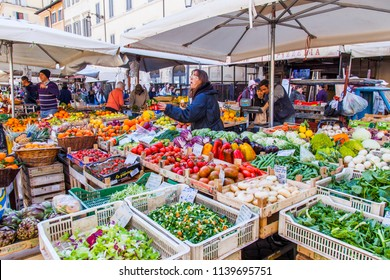 ROME, ITALY, on March 11, 2017. Various vegetables and fruit are laid out on market counters at Campo Di Fiori Square