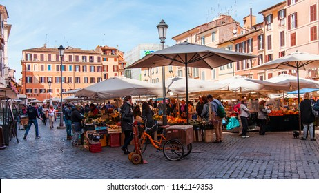 ROME, ITALY, on March 11, 2017. Various vegetables and fruit are laid out on market counters at Campo Di Fiori Square. Sellers and buyers